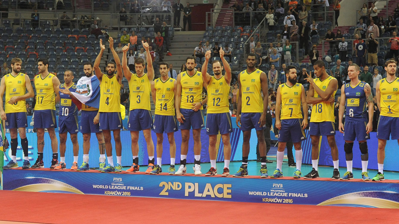 Brazil's players celebrate their second place on the podium during the awarding ceremony of the Volleyball World League Finals, in Krakow, Poland, July 17, 2016. (AP Photo/Alik Keplicz)