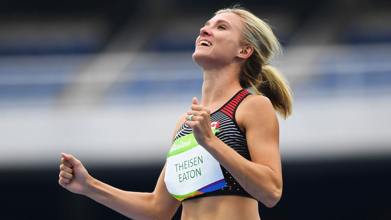 Canada's Brianne Theisen-Eaton, centre, celebrates a successful high jump event during the women's heptathlon at the 2016 Olympic Games in Rio de Janeiro, Brazil on Saturday, Aug. 12, 2016. She won Olympic bronze the next night.