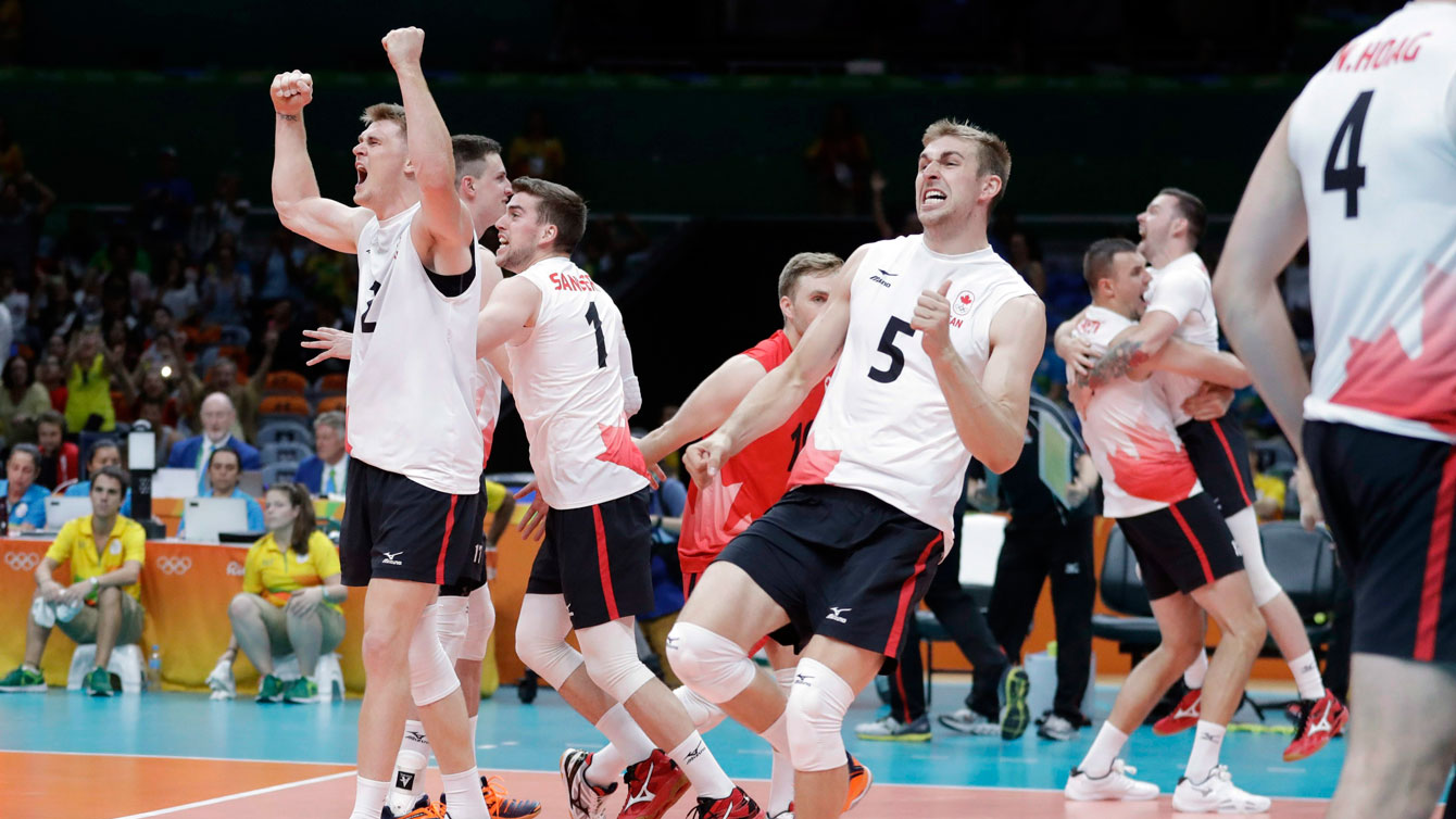 Canadian players celebrate beating the United States in Olympic volleyball in Rio de Janeiro on August 7, 2016.
