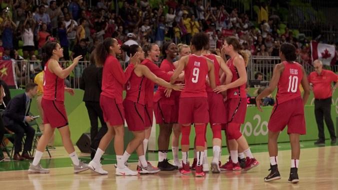 Women's basketball team huddling