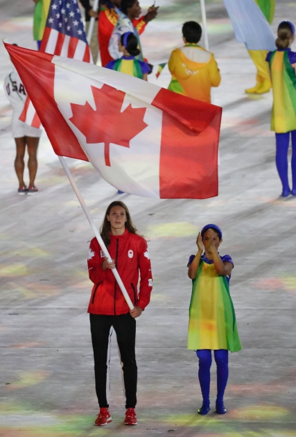Penny Oleksiak carries the flag in the closing ceremonies during Rio 2016 on August 21, 2016. (COC/Jason Ransom)