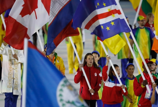Penny Oleksiak carries the flag in the closing ceremonies during Rio 2016 on August 21, 2016. (COC/Mark Blinch)