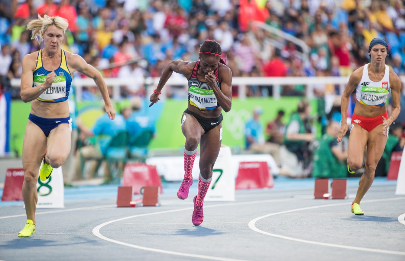Crystal Emmanuel running in the 200m heats