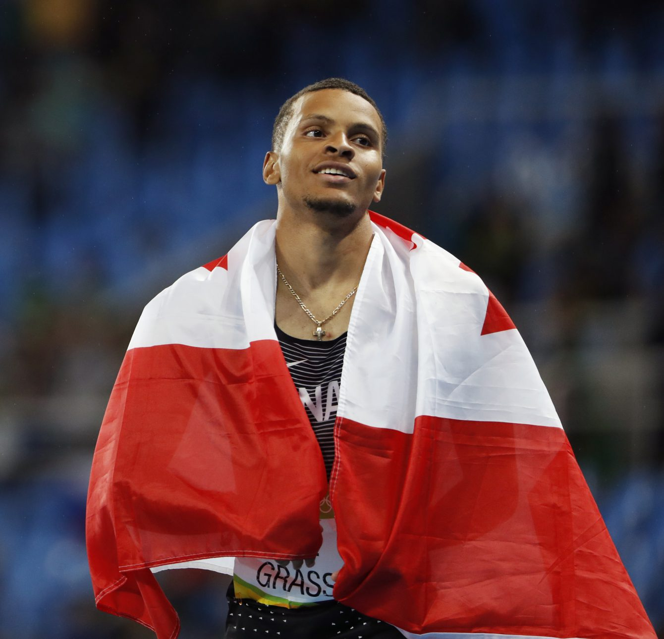 Canada's Andre De Grasse celebrates silver in the men's 200m final at the 2016 Olympic Summer Games in Rio de Janeiro, Brazil on Thursday, Aug. 18, 2016. (photo/ Stephen Hosier)