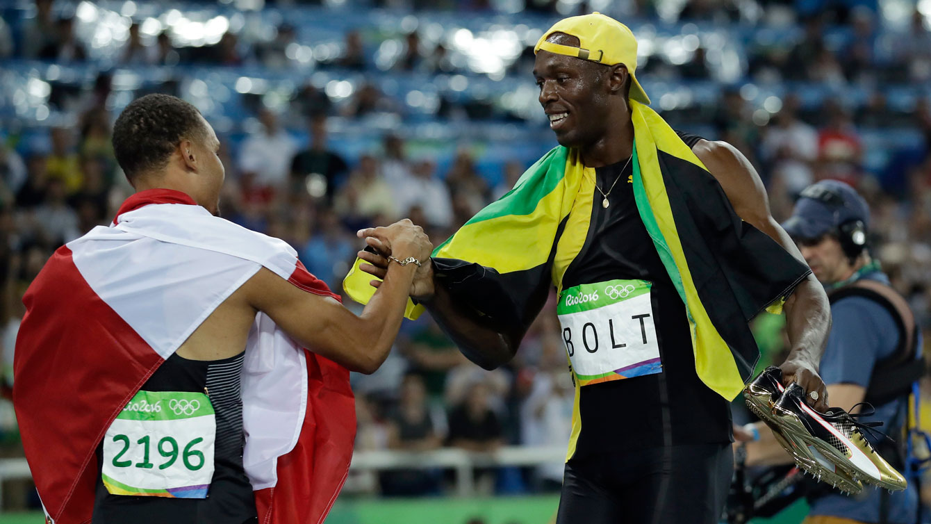 Andre De Grasse (left) and Usain Bolt after their 100m final race at the Olympic Games in Rio de Janeiro on August 14, 2016.