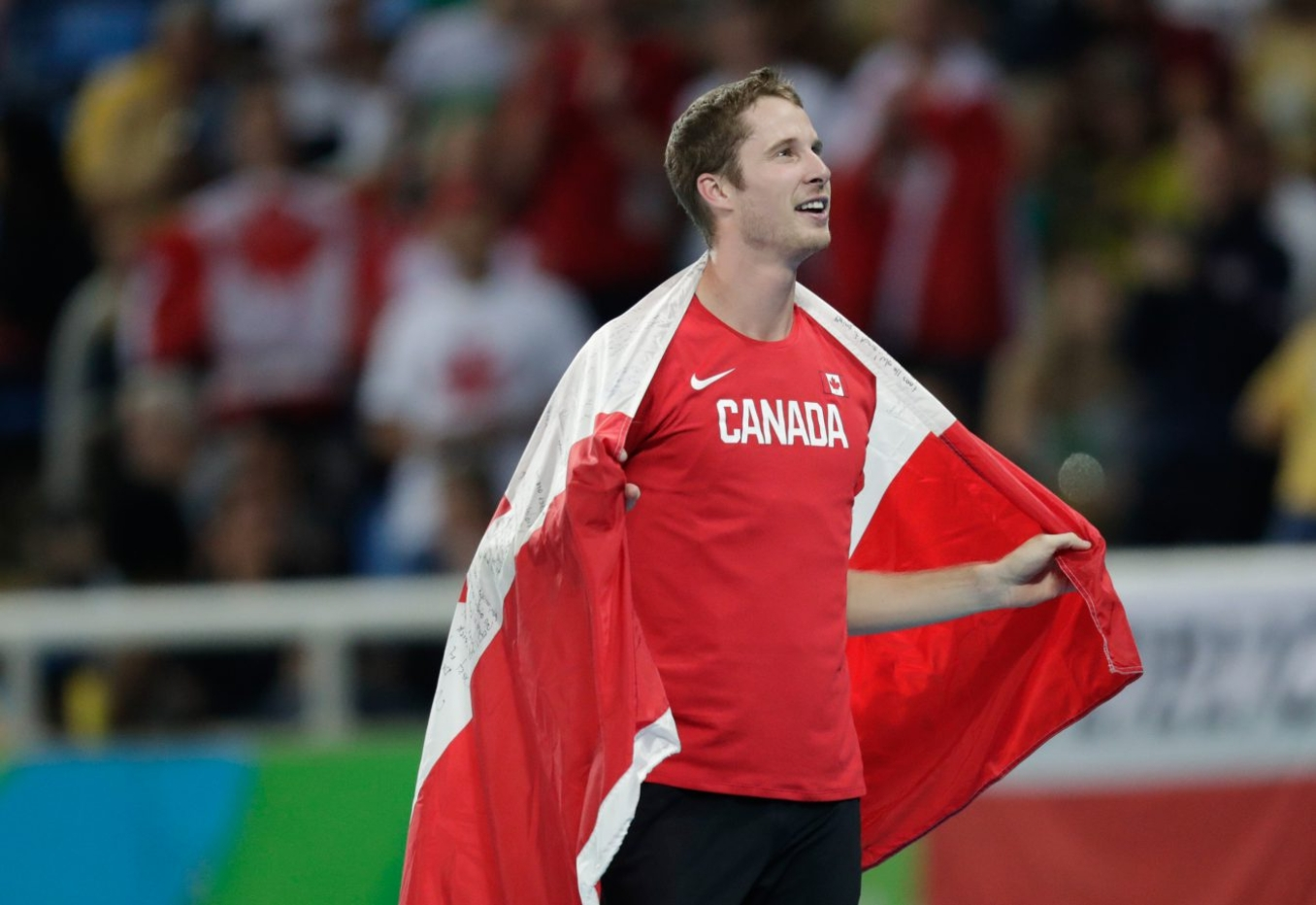 Canada's Derek Drouin celebrates after finishing first in the men's high jump final at the 2016 Summer Olympics in Rio de Janeiro, Brazil, Tuesday, August 16, 2016. (photo/Jason Ransom)
