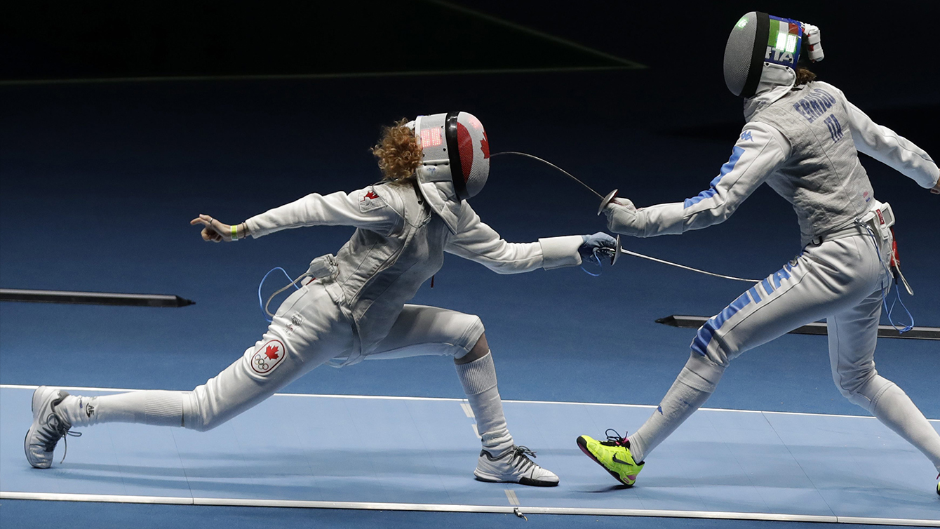 Eleanor Harvey of Canada, left, and Arianna Errigo of Italy compete in a women's individual foil event at the 2016 Summer Olympics in Rio de Janeiro, Brazil, Wednesday, Aug. 10, 2016. (AP Photo/Andrew Medichini)