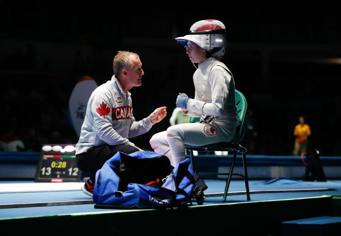 Eleanor Harvey sits between periods of her quarterfinal bout of the women's individual foil at Rio 2016 (Photo: COC/Mark Blinch, August 10, 2016)