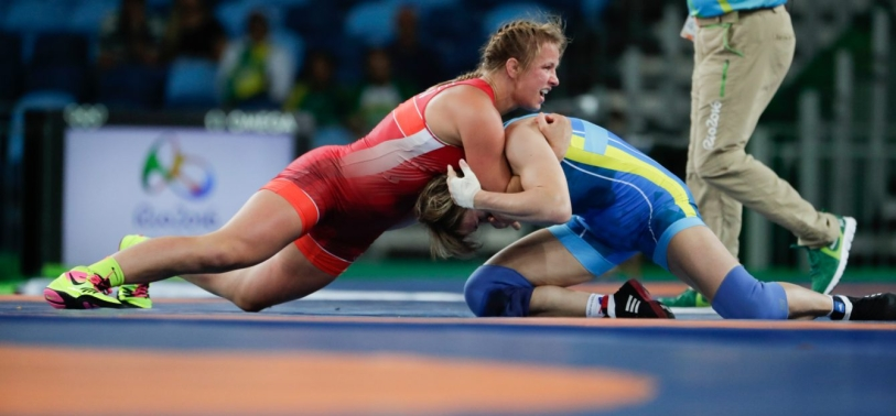 Canada's Erica Wiebe, red, competes against Kazakhstan's Guzel Manyurova during the women's 75kg freestyle wrestling competition at the 2016 Summer Olympics in Rio de Janeiro, Brazil, Thursday, Aug. 18, 2016. (COC/Jason Ransom)