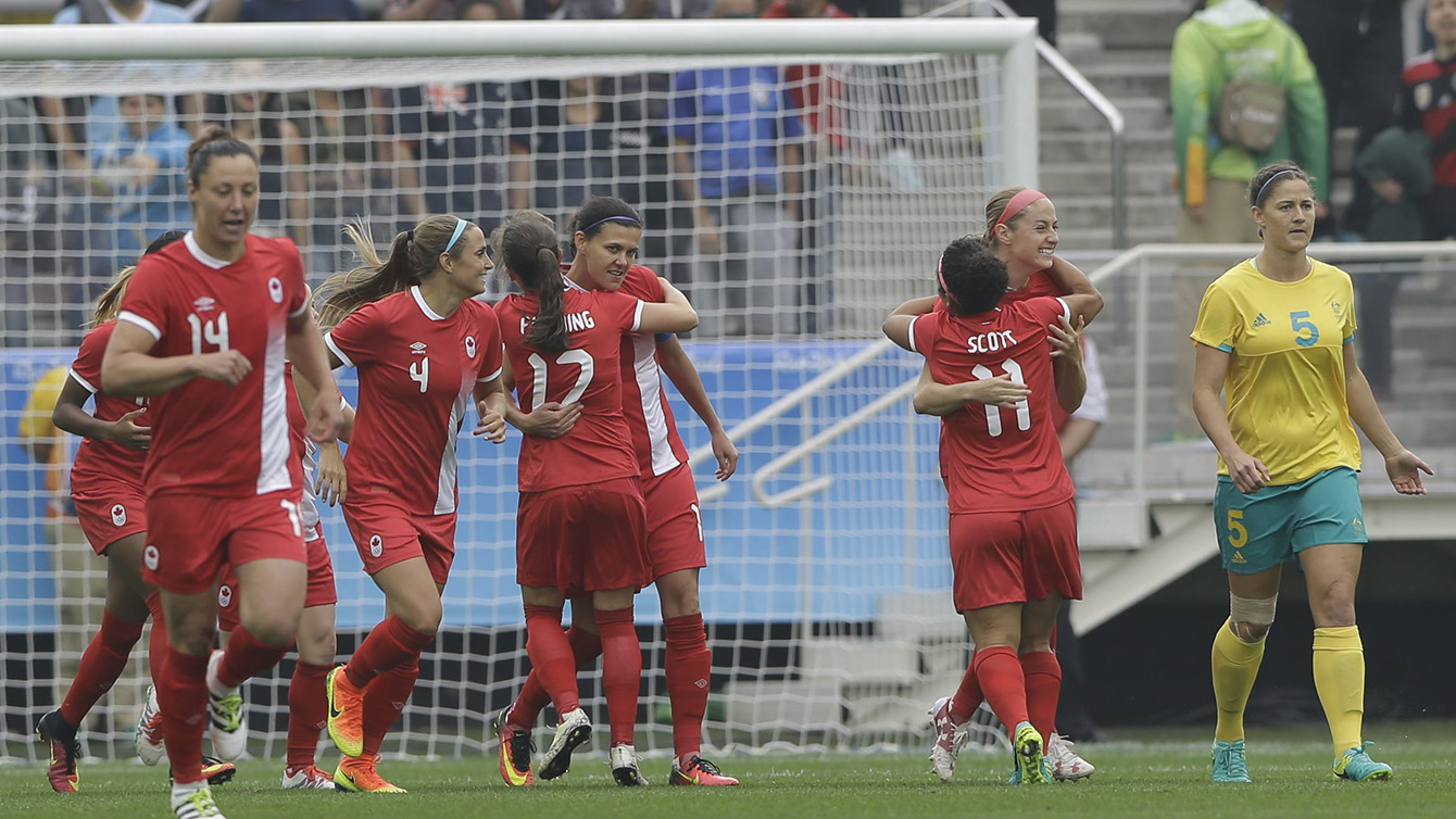 Canada players celebrate after Janine Beckie, scored her team's first goal during the 2016 Summer Olympics football match between Canada and Australia, at the Arena Corinthians, in Sao Paulo, Brazil, Wednesday, Aug. 3, 2016. (AP Photo/Nelson Antoine)