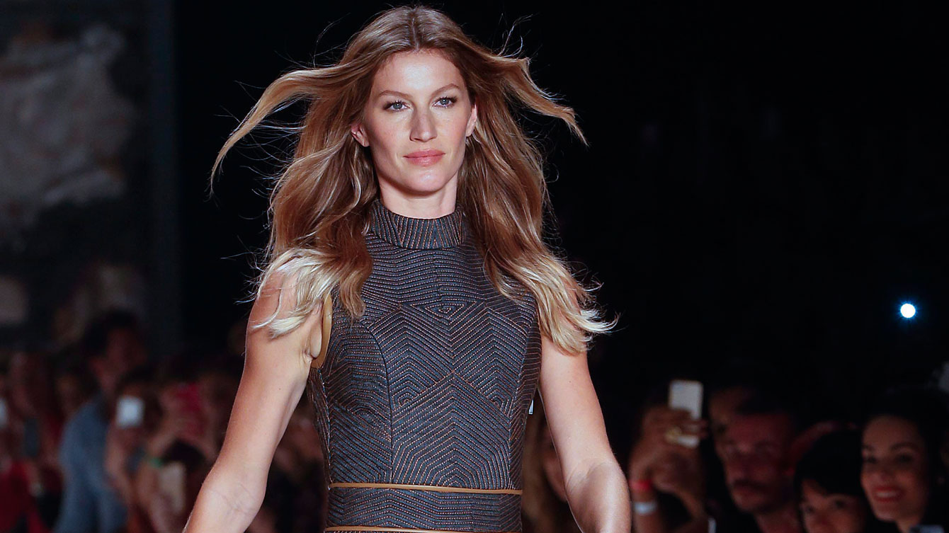 Brazilian model Gisele Bundchen wears a creation from the Colcci Winter collection during the Sao Paulo Fashion Week in Sao Paulo, Brazil. (AP Photo/Andre Penner)