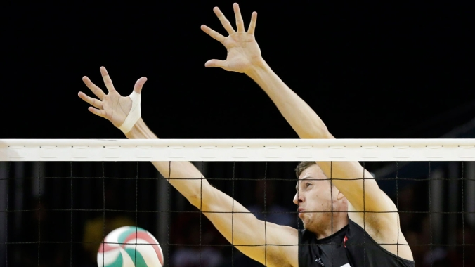 Canada's Graham Vigrass fails to block against Argentina during a men's volleyball semifinal match at the Pan Am Games in Toronto, Ontario, Friday, July 24, 2015. (AP Photo/Felipe Dana)