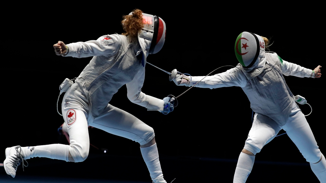 Eleanor Harvey of Canada, left, competes with Anissa Khelfaoui of Algeria women's individual foil event at the 2016 Summer Olympics in Rio de Janeiro, Brazil, Wednesday, Aug. 10, 2016. (AP Photo/Andrew Medichini)