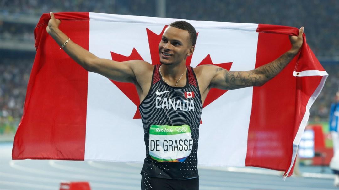 Andre de Grasse celebrating with Canadian flag