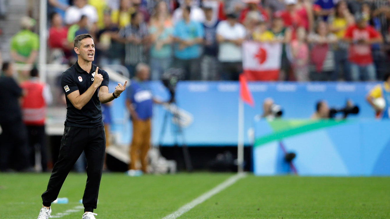 John Herdman instructs his players during Canada's Olympic women's football match against Zimbabwe on August 6, 2016.