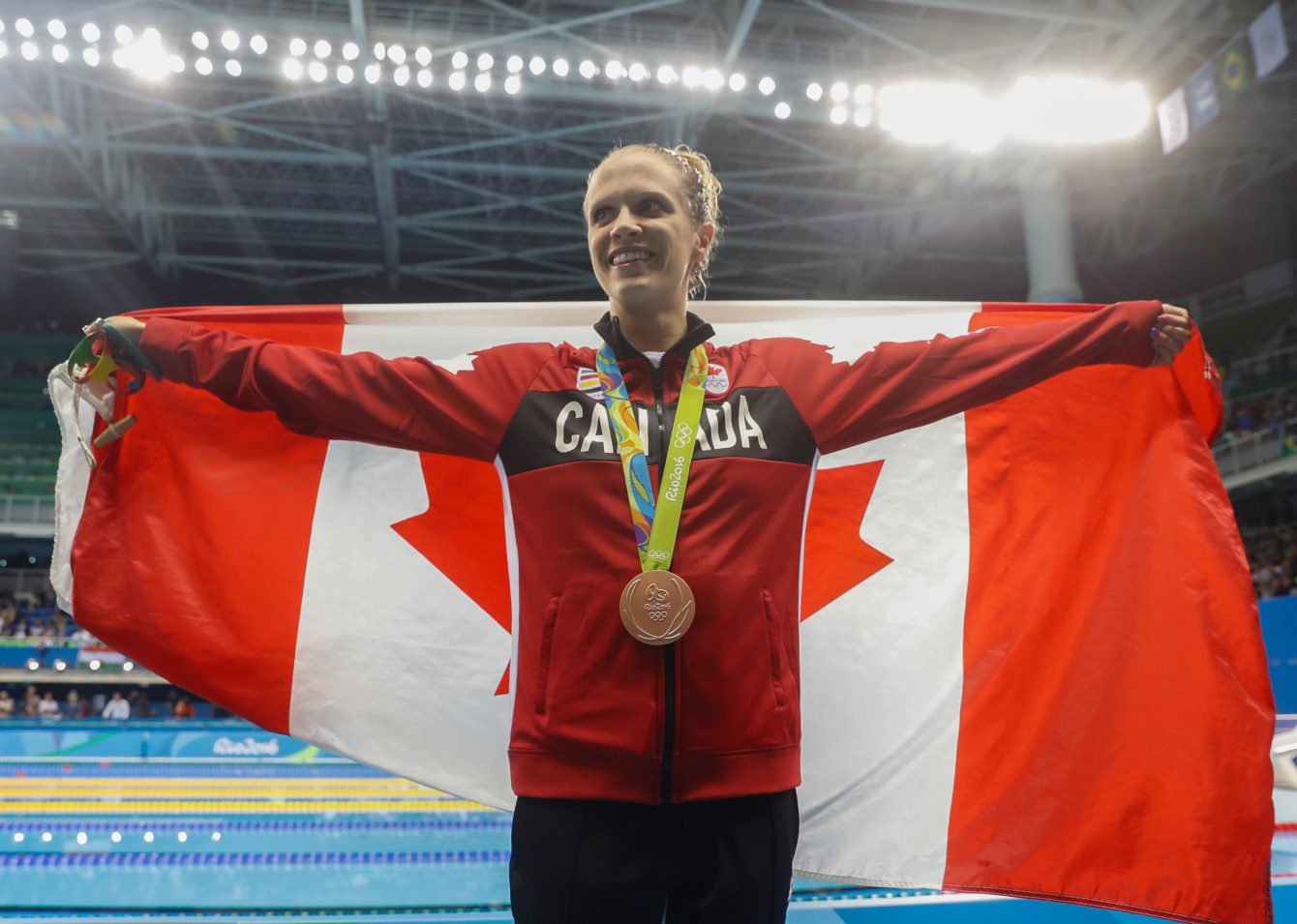 Canada's Hilary Caldwell with her bronze medal from winning the bronze medal in the women's 200-meter backstroke final during the swimming competitions at the 2016 Summer Olympics, Thursday, Aug. 12, 2016, in Rio de Janeiro, Brazil. (COC Photo/Mark Blinch)