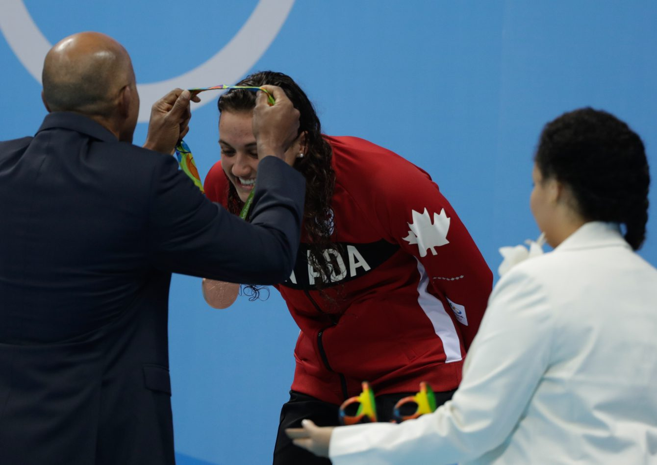 Canada's Kylie Masse being awarded her bronze medal after her 100m backstroke race on August 8, 2016 (photo/Jason Ransom)