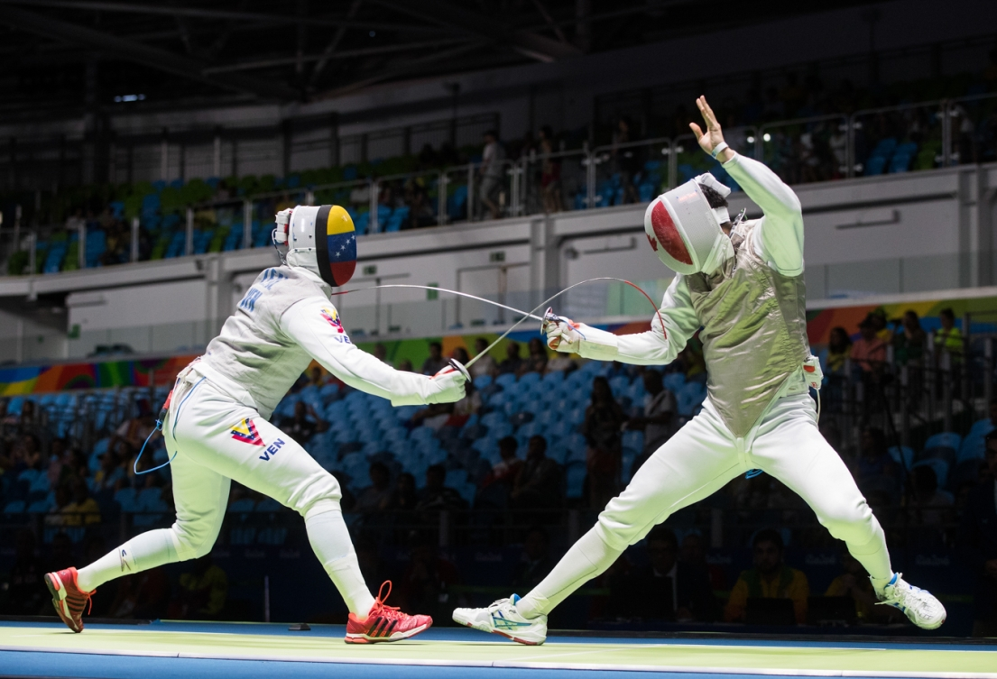 Canada's Maximilien van Haaster, right, competes against against Venezuela's Antonio Leal in their Men's Foil Individual Table of 64 fencing match