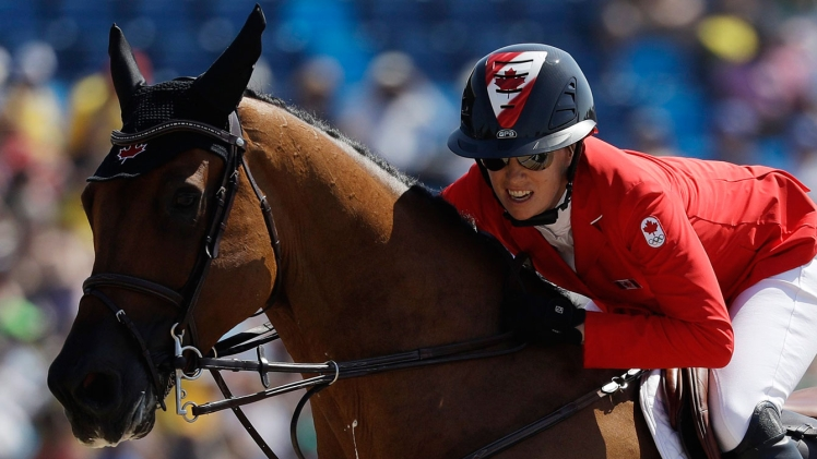 Amy Millar on horse jumping during equestrian event