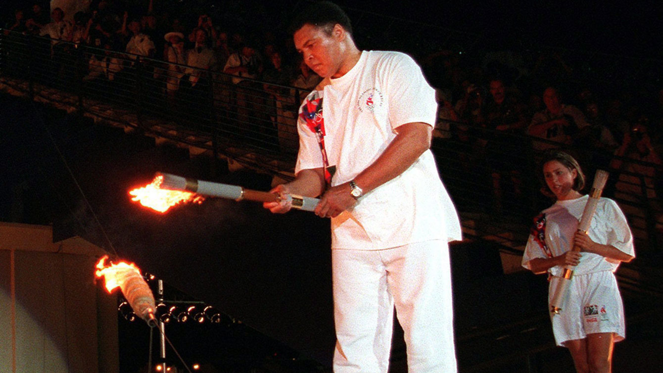 Muhammad Ali lights the Olympic flame during the Atlanta 1996 Opening Ceremony (AP Photo/Michael Probst)
