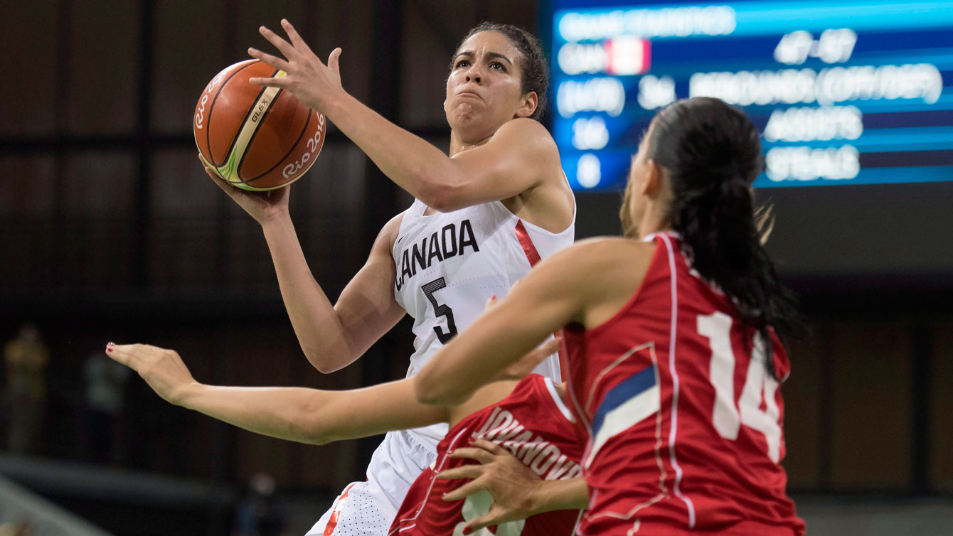 Kia Nurse with the ball trying to get around a defender