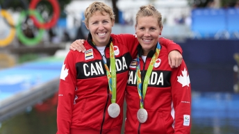 Patricia Obee (left), Lindsay Jennerich after winning Olympic silver