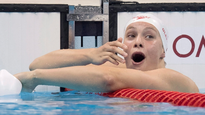 Penny Oleksiak reacts after seeing she won silver in 100m butterfly at Rio 2016 on August 7, 2016.