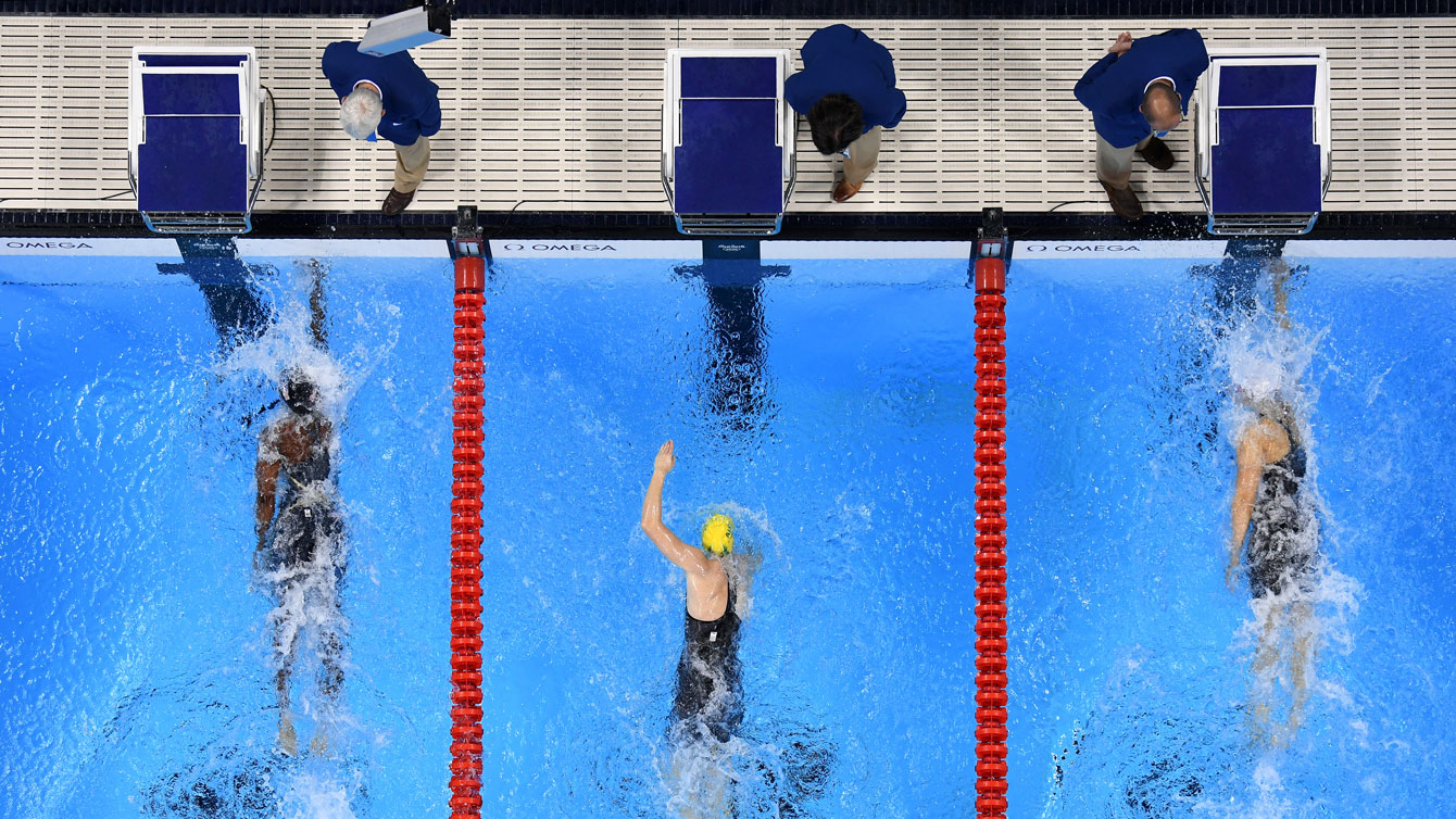 Penny Oleksiak (right) and Simone Manuel (left) touch the wall simultaneously in the 100m freestyle at the Olympic Games in Rio de Janeiro on August 11, 2016.