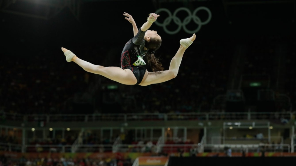 Isabela Onyshko competing in the all around beam competition in Rio 2016.