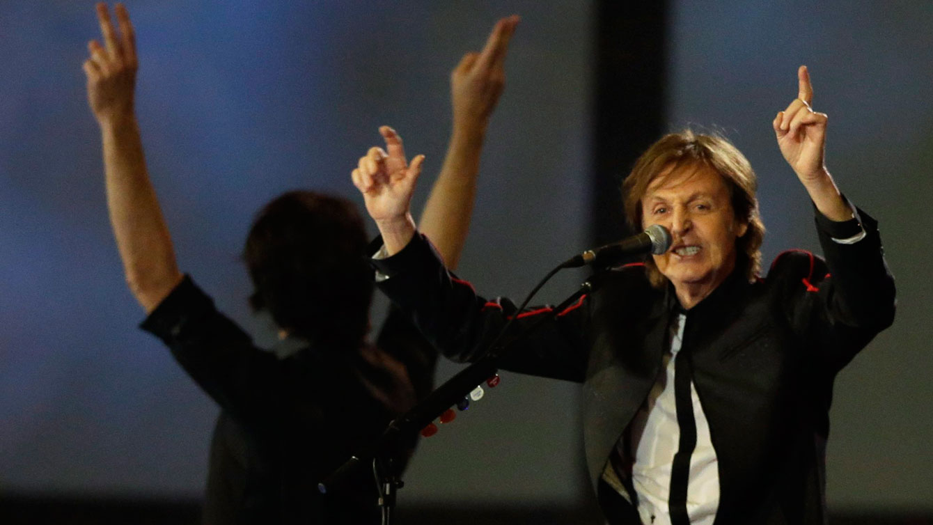 Sir Paul McCartney performs during the London 2012 Opening Ceremony. (AP Photo/Mark Humphrey)