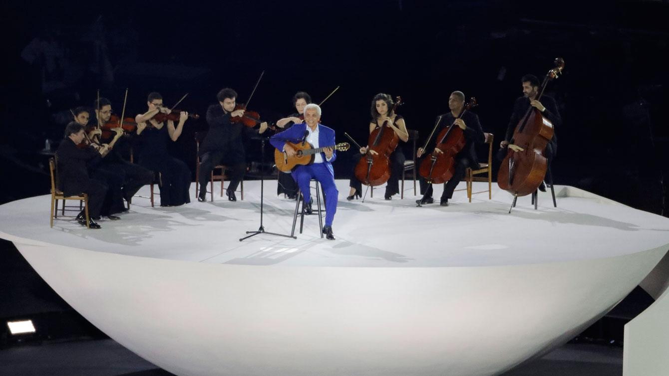 Paulinho da Viola sings Brazil's national anthem at Rio 2016 Opening Ceremony, Friday, Aug. 5, 2016. (AP Photo/Charlie Riedel)
