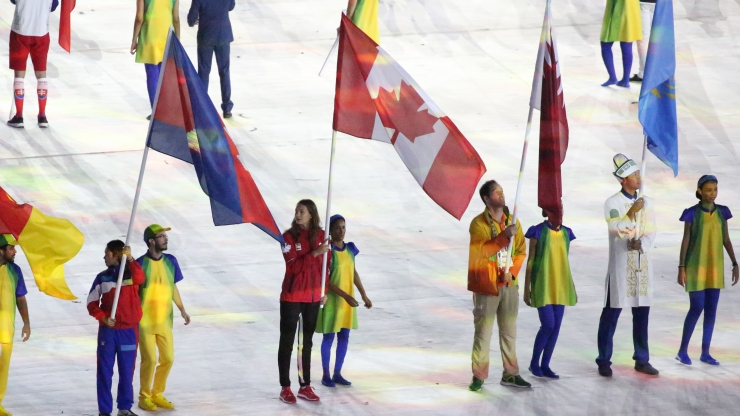 Penny Oleksiak carries the flag in the closing ceremonies during Rio 2016 on August 21, 2016. (COC/Steve Bourdreau)