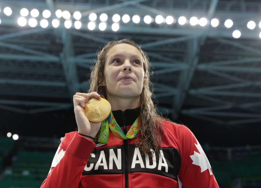 Canada's Penny Oleksiak with her gold medal after finishing first in the women's 100-meter freestyle during the swimming competitions at the 2016 Summer Olympics, Thursday, Aug. 11, 2016, in Rio de Janeiro, Brazil. (COC photo/JasonRansom)