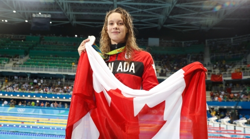 Penny Oleksiak poses with her silver medal after finishing second in the 100m butterfly