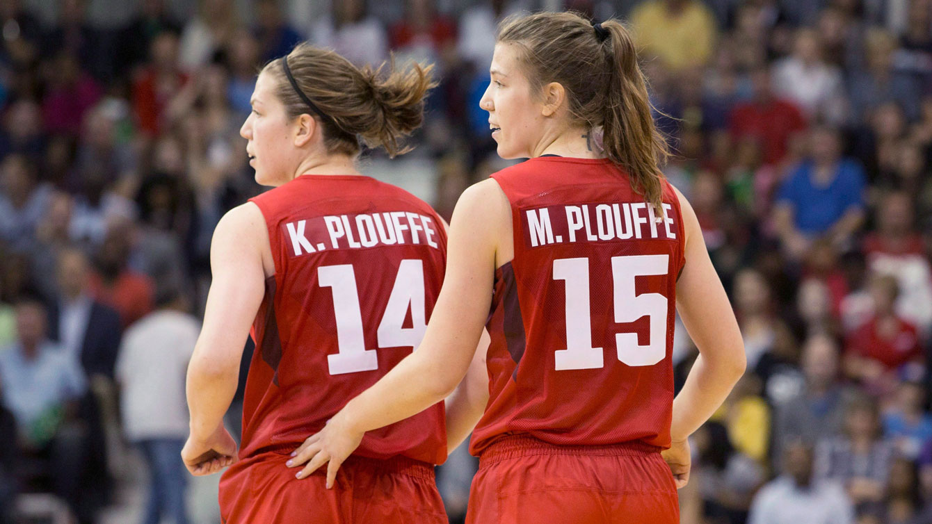 Michelle Plouffe (right) jogs back to her defensive position with sister Katherine during women's basketball action against Argentina at the Pan Am games in Toronto on Friday, July 17, 2015. THE CANADIAN PRESS/Chris Young