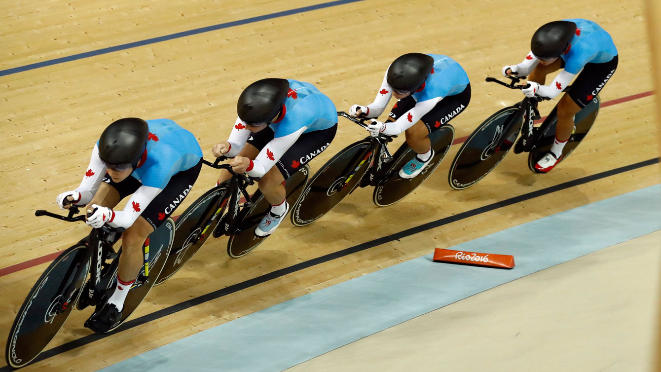 Canada's team compete in the women's team pursuit first round at the Rio Olympic Velodrome during the 2016 Summer Olympics in Rio de Janeiro, Brazil, Saturday, Aug. 13, 2016. (AP Photo/Patrick Semansky)