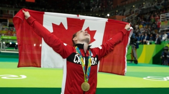 Rosie Holding Canadian flag in Rio 2016