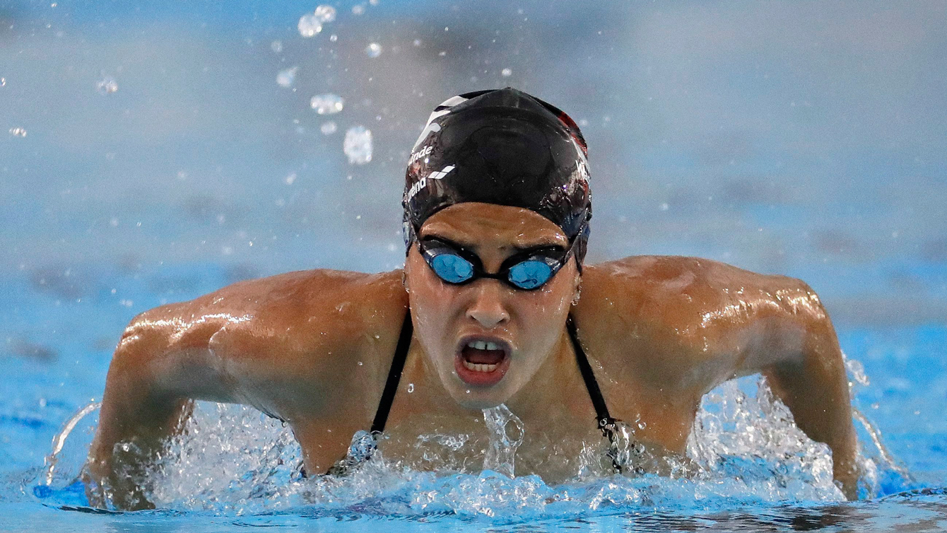 Olympic refugee team member Yusra Mardini swims practice laps at the Olympic Aquatics Stadium ahead of the Rio Olympics in Rio de Janeiro, Brazil, Thursday, July 28, 2016. Mardini is one of ten athletes on the first ever refugee team having fled war-torn Syria. (AP Photo/Charlie Riedel)
