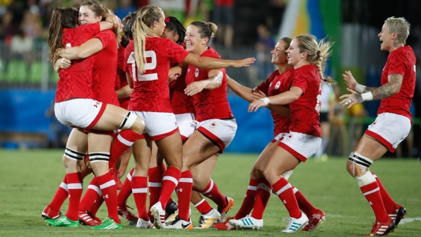 Canada celebrates their bronze medal win over Great Britain in women's rugby sevens at the 2016 Olympic Games in Rio de Janeiro, Brazil on Monday, Aug. 8, 2016. (COC/Mark Blinch)
