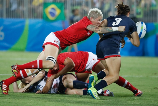 Jen Kish attempts a tackle during the bronze medal match against Great Britain in women's rugby sevens at the 2016 Olympic Summer Games in Rio de Janeiro, Brazil on Monday, Aug. 8, 2016. (Photo/ Mark Blinch)