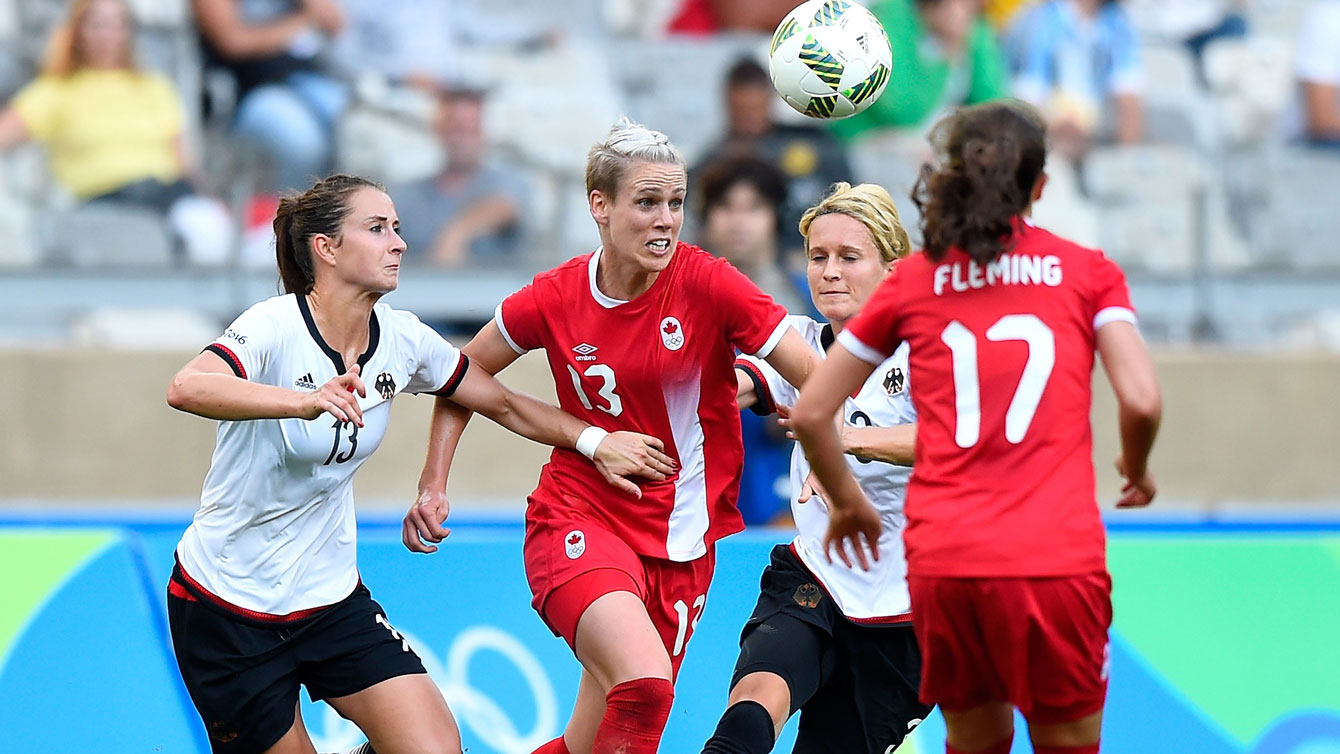 Sophie Schmidt (13) of Canada battles for a ball against Germany in the Olympic football semifinals on August 16, 2016.