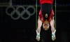 What are the differences between artistic gymnastics and rhythmic gymnastics?