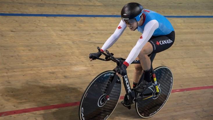 Simmerling racing on bike in velodrome