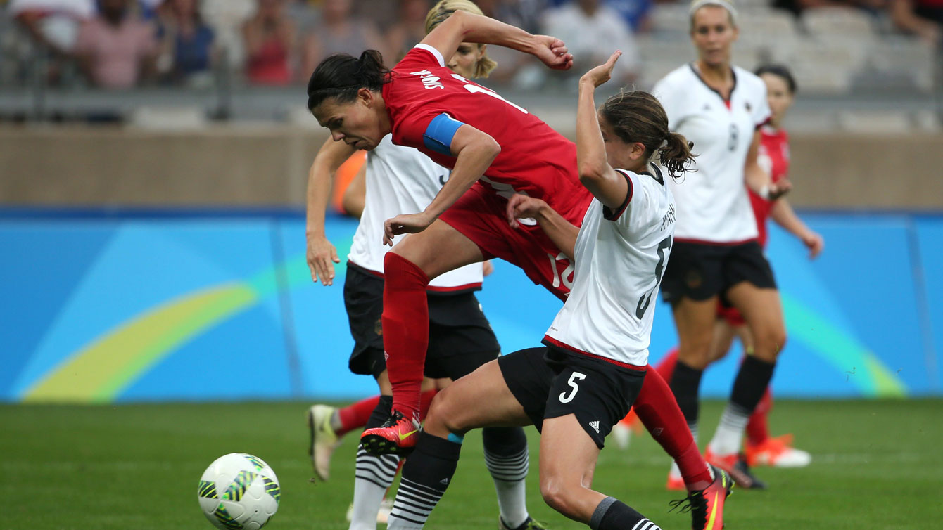 Christine Sinclair tries to get through two German defenders in an Olympic semifinal match for Canada on August 16, 2016.