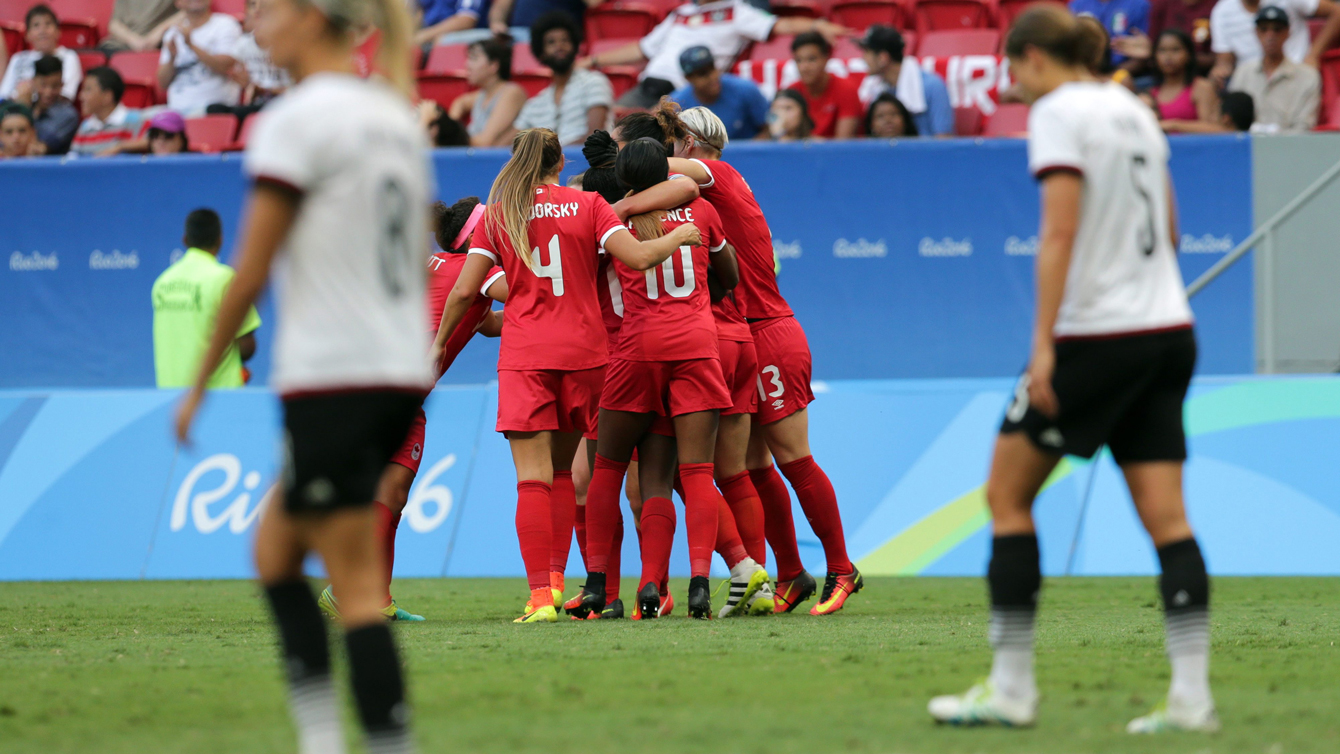Canada's players celebrate after scoring their second goal during a F match of the women's Olympic football tournament between Germany and Canada at the National Stadium, in Brasilia, Brazil, Tuesday, Aug. 9, 2016. (AP Photo/Eraldo Peres)