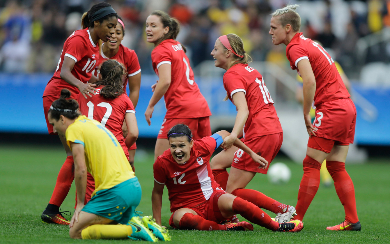 Canada's Christine Sinclair, center, celebrates with teammates after scoring her team's second goal during the 2016 Summer Olympics football match at the Arena Corinthians in Sao Paulo, Brazil, Wednesday, Aug. 3, 2016. Canada won 2-0. (AP Photo/Nelson Antoine)