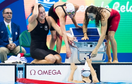 Sandrine Mainville, Chantal Van Landeghem, Taylor Ruck, and Penny Oleksiak celebrate winning bronze in the Women's swimming 4 x 100m Freestyle Relay Final qualifying at the Olympic games in Rio de Janeiro, Brazil, Saturday August 6, 2016. COC Photo/Mark Blinch