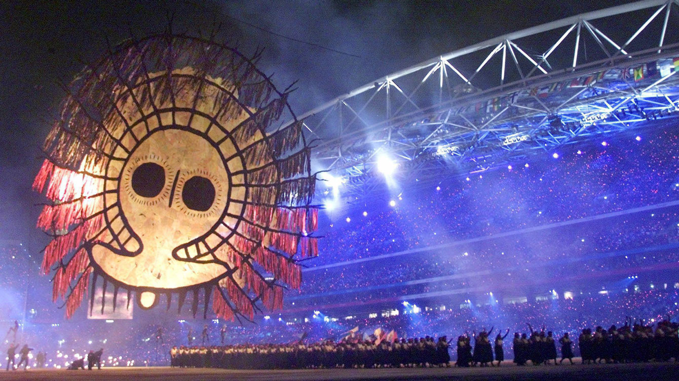 An Aboriginal icon is raised during the Opening Ceremony of Sydney 2000 at the Olympic Stadium, Sept. 15, 2000. (AP Photo/David Guttenfelder)