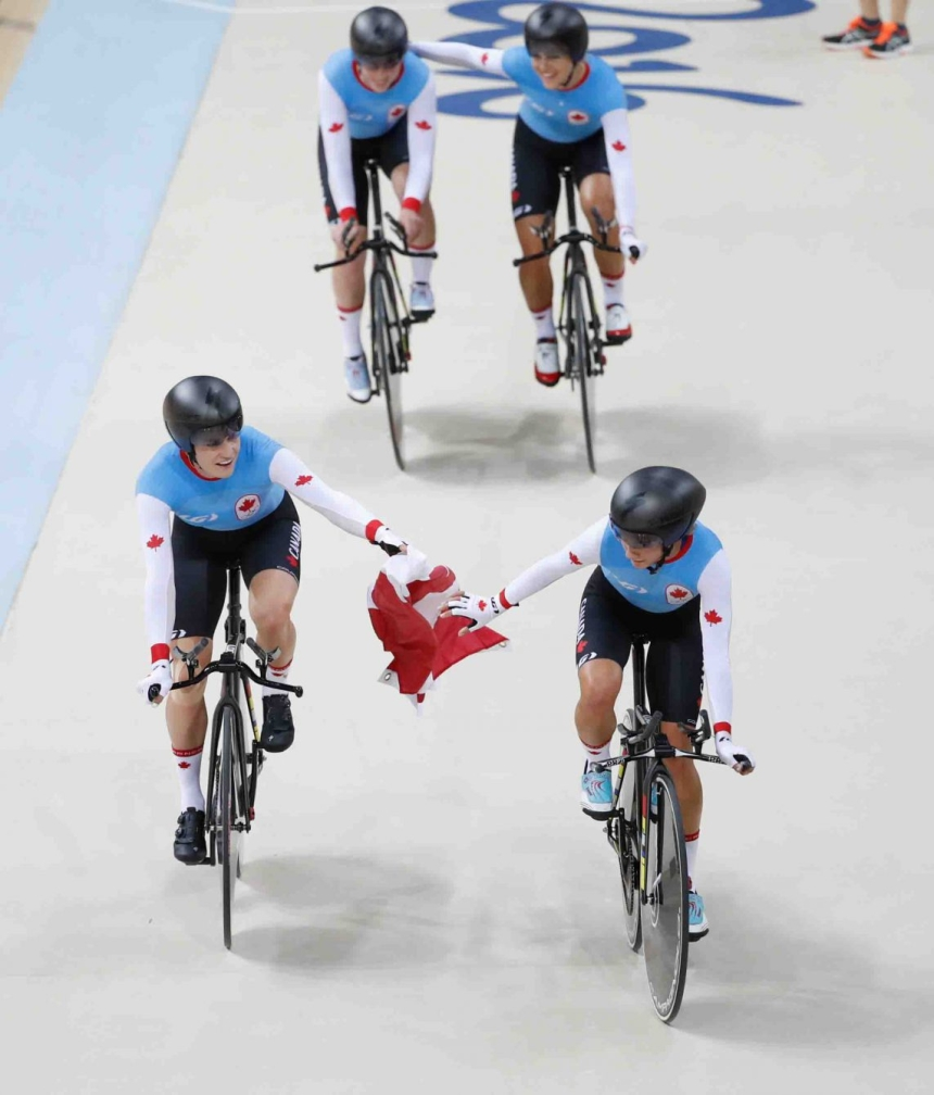 Canada's women's team pursuit team with the Canadian flag after winning the bronze medal at the velodrome at the Olympic games in Rio de Janeiro, Brazil, Saturday August 13, 2016. (photo/ Mark Blinch)