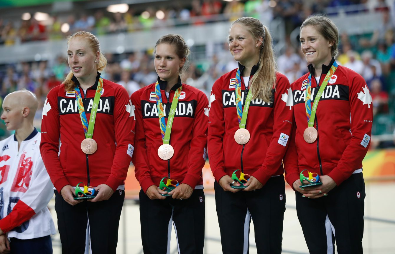 Canada's women's team pursuit team Allison Beveridge, Jasmin Glaesser, Kirsti Lay, and Georgia Simmerling with their bronze medals at the velodrome at the Olympic games in Rio de Janeiro, Brazil, Saturday August 13, 2016. (photo/ Mark Blinch)
